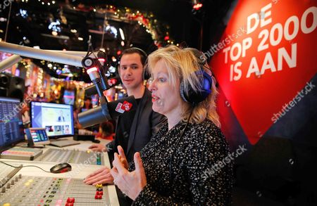 Dutch Minister of Education Culture and Science Jet Bussemaker (r) Helps Radio Dj Bart Arens (c) of the Dutch National Radio Station Radio 2 to Kick Off the Annual 'Top 2000' Countdown in Hilversum the Netherlands 25 December 2015 This Marathon Radio Program Plays the 2 000 Most Popular Songs of All Time From Christmas Through to New Year's Eve Netherlands Hilversum