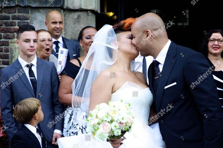Dutch Dj Sidney Samson (r) and Dutch Singer Eva Simons (l) Kiss After Getting Married at the Westerkerk Church in Amsterdam the Netherlands 14 July 2014 Samson Popped the Question to Simons During Their Trip to Monaco Six Months Ago Netherlands Amsterdam