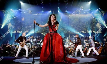 Stock Picture of Singer Sharon Den Adel (c) of Dutch Gothic Rock Group Within Temptation Performs on Stage During Their Concert in Ahoy Rotterdam the Netherlands 07 February 2008 Within Temptation Performs Together with the Metropole Orchestra Under Jules Buckley Netherlands Rotterdam