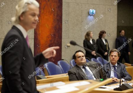 Dutch Prime Minister Mark Rutte (r) and Finance Minister Jan Kees De Jager (c) Look at Pvv Party Leader Geert Wilders During a Debate on Budget Cuts at the Parliamenmt in the Hague the Netherlands 26 April 2012 Netherlands the Hague