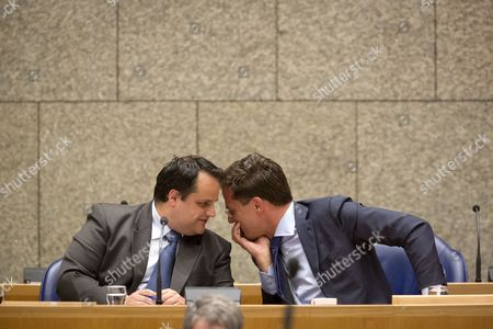 Dutch Finance Minister Jan Kees De Jager (l) and Prime Minister Mark Rutte Talk During a Debate on Budget Cuts at the Parliamenmt in the Hague the Netherlands 26 April 2012 Netherlands the Hague