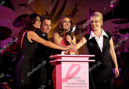 British Actress Elizabeth Hurley (2-r) Pushes a Button with Dutch Presenter Quinty Trustfull (l) Manager of Estee Lauder Netherlands Henk Van Der Mark and Musical Star Chantal Janzen (r) During the Pink Ribbon Gala at the Concertgebouw in Amsterdam the Netherlands 29 September 2008 by Pushing the Button They Set the Concertgebouw Building in Pink Light the Event was Organised to Raise More Attention to Breast Cancer Netherlands Amsterdam