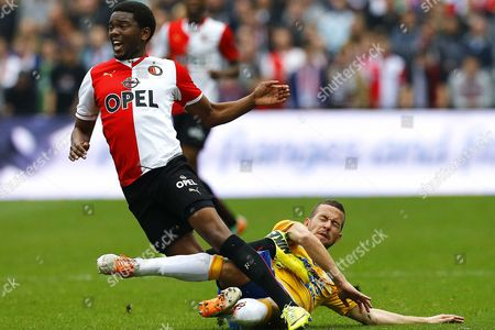 Feyenoord Rotterdam's Miquel Nelom (l) in Action Against Rkc Waalwijk's Kenny Anderson (r) During the Dutch Eredivisie Soccer Match Between Feyenoord Rotterdam and Rkc Waalwijk in Rotterdam Netherlands 06 April 2014 Netherlands Rotterdam