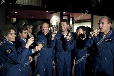 Noo01-20001220-noordwijk Netherlands: European Space Agency (esa) Astronauts Raise Their Glasses at the Space Exhibition in Noordwijk Wednesday 20 December 2000 the Astronauts Gather in Noordwijk to Receive Informations About the International Space Station (iss) Umberto Guidoni of Italy who was not Present at the Meeting Will Undertake the Next Flight to the Station Which Will Be Ready in 2005 (from Left) Claudie Andre-deshays (france) Leopold Eyharts (france) Claude Nicollier (switzerland) Thomas Reiter (germany) Reinhold Ewald (germany) and Andre Kuipers (netherlands) Epa Photo Anp/robert Vos Netherlands Noordwijk