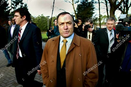 Nld05 - 20020125 - Zeist Netherlands - the New Dutch Soccer Coach Dick Advocaat (c) is Flanked by His Assistent Willem Van Hanegem (l) As They Arrive in Zeist For Press Conference 25 January 2002 Dick Advocaat Rangers' Director of Football Will Also Take Charge of the Holland National Team From July This Year in a Joint Role the Dutch Football Federation Said on Friday Knvb Executive Director Hans Kessler Said They Had Agreed with Rangers' Bosses That From July 1 Advocaat Would Be in His New Job For Four Days a Week and From the Summer of 2003 when His Rangers Contract Expires He Would Take Over the Dutch Post Full Time Epa Photo Anp/olaf Kraak Netherlands Zeist