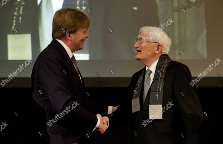 Stock Image of Dutch King Willem-alexander (l) Congratulates Winner of the Erasmus Prize German Philosopher Jurgen Habermas (r) in the Royal Palace in Amsterdam the Netherlands 06 November 2013 the Erasmus Prize is an Annual Prize Awarded by the Praemium Erasmianum Foundation a Dutch Non-profit Organization to Individuals Or Institutions That Have Made Notable Contributions to European Culture Society Or Social Science Netherlands Amsterdam