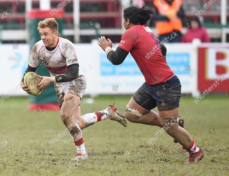 Stock Image of Harry Strong of Plymouth Albion under pressure from Freddie Tuilagi of Coventry during the match, between Plymouth Albion and Coventry at the Brickfields Recreation Ground, on February 11th 2017 in Plymouth, UK.