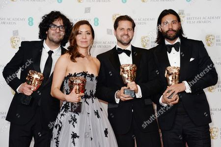 Stock Image of Babak Anvari, Emily Leo, Oliver Roshill and Lucan Toh - Outstanding Debut for British Writer, Director and Producer - Under the Shadow