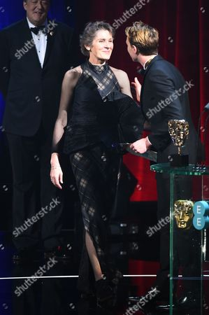 Stock Photo of George MacKay and Madeline Fontaine - Costume Design - 'Jackie'