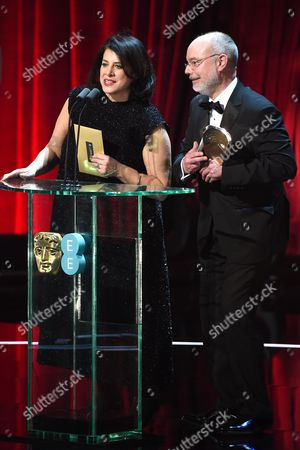 Stock Photo of Anna Pinnock and James Hambidge, winners of the 'Production Design' award for 'Fantastic Beasts And Where To Find Them'