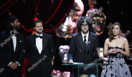 Babak Anvari, Emily Leo, Oliver Roskill and Lucan Toh, winners of the Outstanding Debut by a British Writer, Director or Producer for 'Under The Shadow'