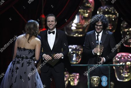 Rafe Spall with Babak Anvari, Emily Leo, winners of the Outstanding Debut by a British Writer, Director or Producer for 'Under The Shadow'