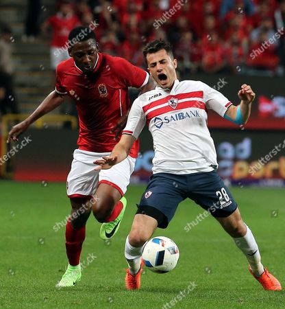 Al-Ahly' Jounir Agay  (L) fights for the ball with Zamalek player Mahmoud Hamdy (R) during the Egyptian Super Cup soccer match between Al-Ahly and  Al-Zamelk at Mohammed Bin Zayed Stadium in Abu Dhabi, United Arab Emirates, 10 February 2017.