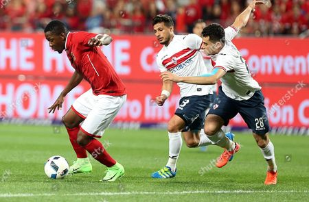 Al-Ahly' Jounir Agay  (L) fights for the ball with Zamalek player Tarek Hamed (C) and Mahmoud Hamdy (R) during the Egyptian Super Cup soccer match between Al-Ahly and  Al-Zamelk at Mohammed Bin Zayed Stadium in Abu Dhabi, United Arab Emirates, 10 February 2017.