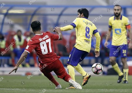 Al-Wehda player Sharif Hazem (L) in action for the ball with Al-Nassr player Yahya Al-Shehri (R) during the Saudi Professional League Soccer match between Al-Nassr and Al-Wehda at King Fahd International Stadium, Riyadh, Saudi Arabia, 10 February 2017.