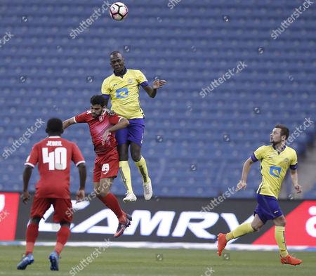 Al-Wehda player Kamel Fallatah (L) in action for the ball with Al-Nassr player Omar Hawsawi (R) during the Saudi Professional League Soccer match between Al-Nassr and Al-Wehda at King Fahd International Stadium, Riyadh, Saudi Arabia, 10 February 2017.