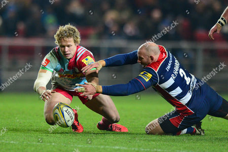 Stock Picture of Matt Hopper of Harlequins and Rob Hawkins of Bristol Rugby closes down the loose ball