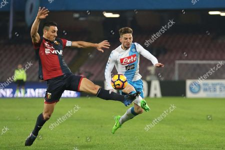 Napoli's forward Dries Mertens, right, avoids the Genoa's defender Nicolas Burdisso, left, before giving the assist to Emanuele Giaccherini for the second goal during the Italian Serie A soccer match between  SSC Napoli and CFC Genoa at San Paolo stadium in Naples, Italy, 10 February 2017.