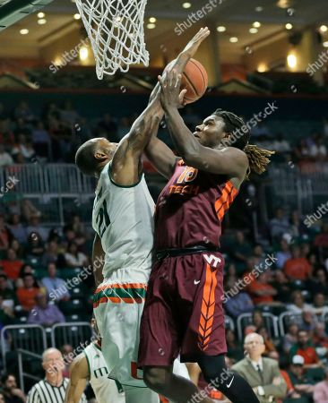Chris Clarke, Kamari Murphy Miami forward Kamari Murphy, left, blocks a shot by Virginia Tech guard Chris Clarke during the first half of an NCAA basketball game, in Coral Gables, Fla