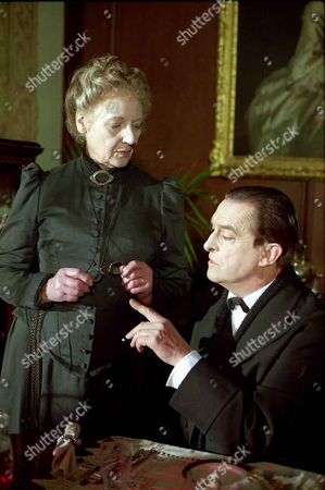 Stock Photo of 'Sherlock Holmes'   TV   1980's Memoirs of Sherlock Holmes: The Golden Pince-Nez  Mrs Marker [Kathleen Byron] and Sherlock Holmes [Jeremy Brett]