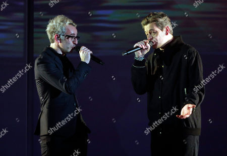 French singer and composer Vincent Delerm, left, and French composer and singer Benjamin Biolay perform on stage during the 32nd Victoires de la Musique, the annual French music awards ceremony, in Paris