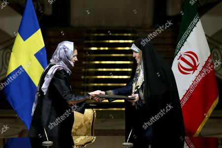 Ann Linde, Shahindokht Molaverdi Sweden's Minister for EU Affairs and Trade Ann Linde, left, and Iran's Vice President for Women and Family Affairs Shahindokht Molaverdi shake hands after signing documents at the Saadabad Palace in Tehran, Iran