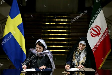 Ann Linde, Shahindokht Molaverdi Sweden's Minister for EU Affairs and Trade Ann Linde, left, and Iran's Vice President for Women and Family Affairs Shahindokht Molaverdi signing documents at the Saadabad Palace in Tehran, Iran