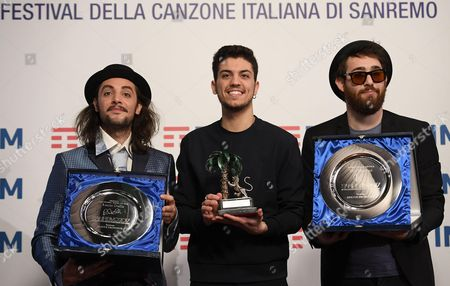 Italian singer Lele (C) poses with the prize after winning in the category 'Youth' next to Italian singer Antonio Prestieri alias Maldestro (R) who won the 'Mia Martini' critic prize and Italian singer Tommaso Pini (L) who won the 'Lucio Dalla' press room prize during the Sanremo Music Festival 2017 at the Ariston theater in Sanremo, Italy, 11 February 2017. The 67th edition of the television song contest runs from 07 to 11 February.