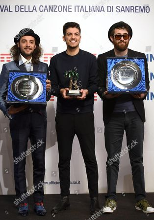 Stock Image of Italian singer Lele (C) poses with the prize after winning in the category 'Youth' next to Italian singer Antonio Prestieri alias Maldestro (R) who won the 'Mia Martini' critic prize and Italian singer Tommaso Pini (L) who won the 'Lucio Dalla' press room prize during the Sanremo Music Festival 2017 at the Ariston theater in Sanremo, Italy, 11 February 2017. The 67th edition of the television song contest runs from 07 to 11 February.