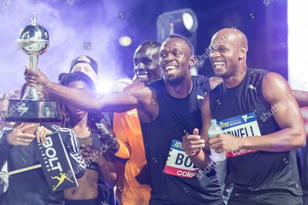 Usain Bolt, Asafa Powell and the Usain Bolt all stars celebrate with the trophy during the 3rd round of the Nitro Athletics  which is a new team-based competition that combines strength, endurance, power and extreme energy.