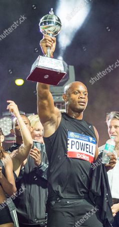 Asafa Powell and the Usain Bolt all stars celebrate with the trophy during the 3rd round of the Nitro Athletics  which is a new team-based competition that combines strength, endurance, power and extreme energy.
