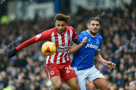 Accrington Stanley Forward, Jonathan Edwards (24) battles with Portsmouth Midfielder, Gareth Evans (26) during the EFL Sky Bet League 2 match between Portsmouth and Accrington Stanley at Fratton Park, Portsmouth