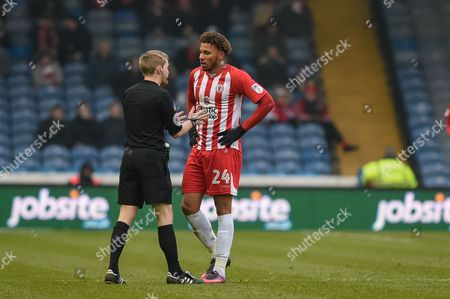 the ref has a word with Accrington Stanley Forward, Jonathan Edwards (24) during the EFL Sky Bet League 2 match between Portsmouth and Accrington Stanley at Fratton Park, Portsmouth