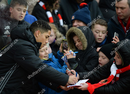 Stock Image of Steven Pienaar of Sunderland signs autographs for fans during the Premier League match between Sunderland and Southampton played at Stadium of Light, Sunderland 11th February 2017