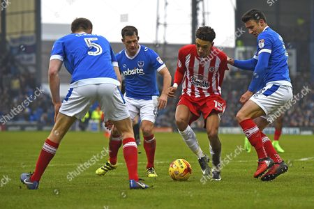 Sean Clare of Accrington Stanley takes on Enda Stevens  (r) Michael Doyle and Matthew Clarke of Portsmouth during Portsmouth vs Accrington Stanley, Sky Bet EFL League 2 Football at Fratton Park on 11th February 2017