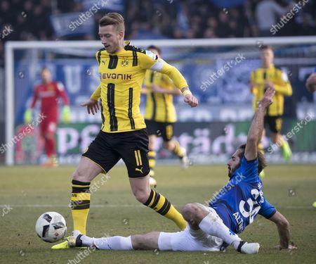 Darmstadt's Hamit Altintop (R) in action against Dortmund's Marco Reus (L) during the German Bundesliga soccer match between SV Darmstadt 98 and Borussia Dortmund in Darmstadt, Germany, 11 February 2017.