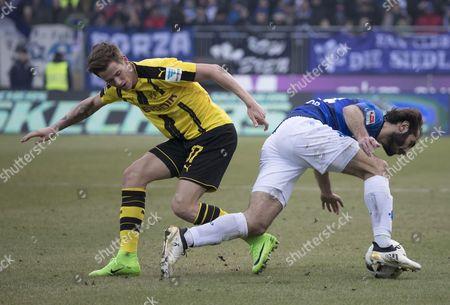 Darmstadt's Hamit Altintop (R) in action against Dortmund's Erik Durm (L) during the German Bundesliga soccer match between SV Darmstadt 98 and Borussia Dortmund in Darmstadt, Germany, 11 February 2017.