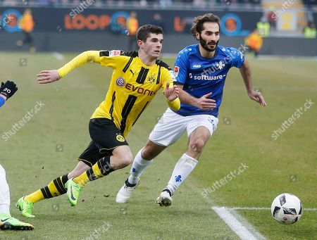 Darmstadt's Hamit Altintop, right, and Dortmund's Christian Pulisic challenge for the ball during a German first division Bundesliga soccer match between SV Darmstadt 98 and Borussia Dortmund in Darmstadt, Germany