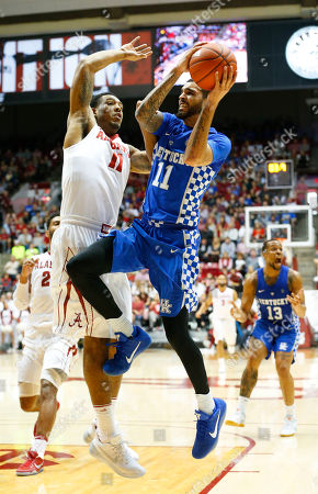 Kentucky guard Mychal Mulder, right, shoots against Alabama forward Shannon Hale during an NCAA college basketball game, in Tuscaloosa, Ala