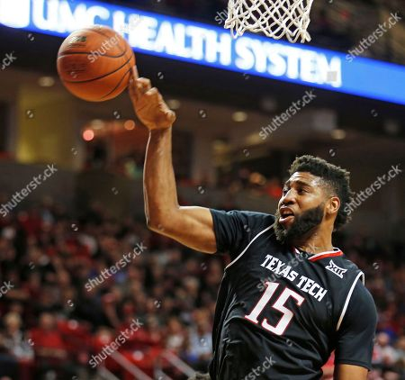 Texas Tech's Aaron Ross (15) tries to rebound the ball during an NCAA basketball game against Kansas, in Lubbock, Texas