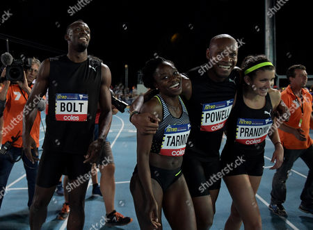 Jamaican sprinter Asafa Powell (centre right) with  American athlete Jeneba Tarmoh (centre), American athlete Jenna Prandini (right) and Jamaican sprinter Usain Bolt in the Mixed 4x100 Meter Relay during the NITRO Athletics series session 3 at Lakeside Stadium in Melbourne, Australia, Saturday, February 11, 2017.