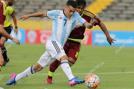 Stock Photo of Argentina's Lucas Rodriguez, left, fights for the ball with Venezuela's Ronaldo Lucena during a U-20 South America qualifying soccer tournament match for the 2017 South Korea U-20 World Cup in Quito, Ecuador