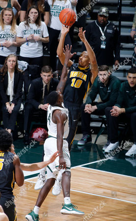Christian Williams, Eron Harris Iowa's Christian Williams (10) shoots over Michigan State's Eron Harris during the first half of an NCAA college basketball game, in East Lansing, Mich