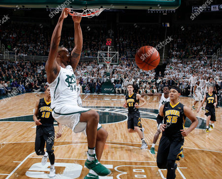 Nick Ward, Cordell Pemsl, Christian Williams Michigan State's Nick Ward, left, dunks against Iowa's Cordell Pemsl (35) and Christian Williams (10) during the first half of an NCAA college basketball game, in East Lansing, Mich