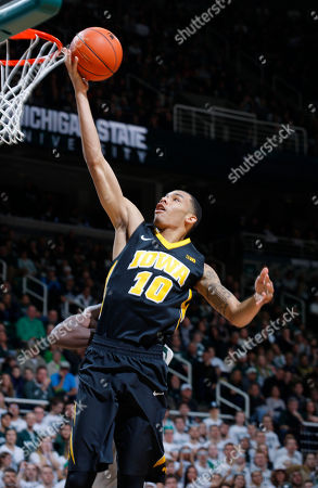 Iowa's Christian Williams gets a layup during the first half of an NCAA college basketball game against Michigan State, in East Lansing, Mich. Michigan State won 77-66