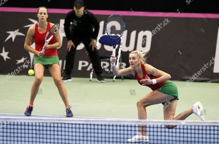 Olga Govortsova (R) and Vera Lapko (L)of Belarus return a ball to  Cindy Burger and Arantxa Rus during the first round of World Group in Fed Cup 2017 doubles tennis match between  Belarus and the Netherlands at the Chizhovka-Arena venue in Minsk, Belarus, 12 February 2017.
