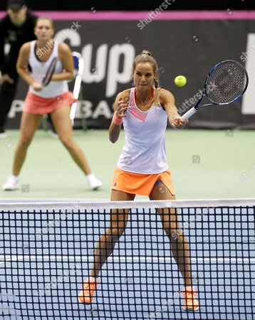 Cindy Burger (L) and Arantxa Rus (R) of the Netherlands returns a ball to Olga Govortsova and Vera Lapko of Belarus during the first round of World Group in Fed Cup 2017 doubles tennis match  between  Belarus and the Netherlands at the Chizhovka-Arena venue in Minsk, Belarus, 12 February 2017.
