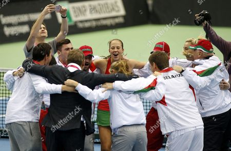 Olga Govortsova (2R) and Vera Lapko (C) of Belarus celebrate with their team their victory after the first round of World Group in Fed Cup 2017 between  Belarus and the Netherlands at the Chizhovka-Arena venue in Minsk, Belarus, 12 February 2017.