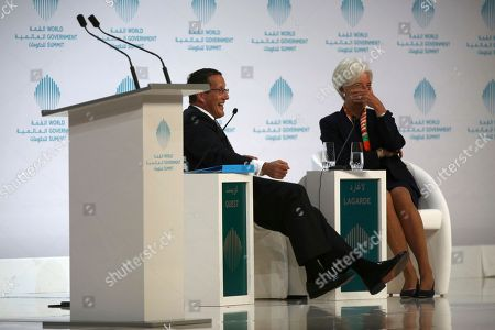 Christine Lagarde, managing director of the International Monetary Fund, reacts to a joke by Richard Quest of CNN in Dubai, United Arab Emirates, . Lagarde spoke as part of the World Government Summit, an annual meeting held in Dubai