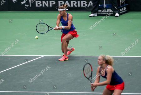 Lucie Safarova and Katerina Siniakova (R) of Czech Republic in action against Spain's Sara Sorribes Tormo and Maria Jose Martinez Sanchez (both unseen) during their double match of the Tennis Fed Cup World Group first round tie between the Czech Republic and Spain in Ostrava, Czech Republic, 12 February 2017.